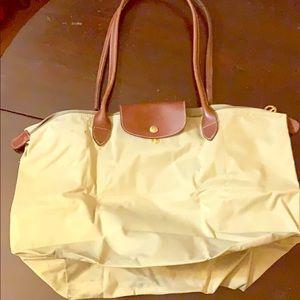 Tan LRGE Longchamps foldable tote